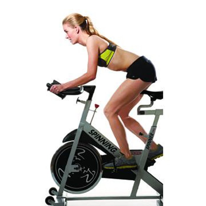 Cycling Workout to Help You Hate Running Less woman stand up