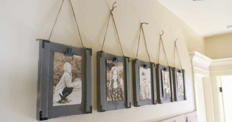 How does the art hanging system add beauty to real estate images?